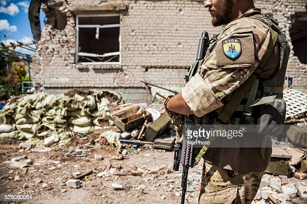 Soldier of the Azov battalion patrolling close to a ukrainian bombed position in Shyrokyne, Ukraine