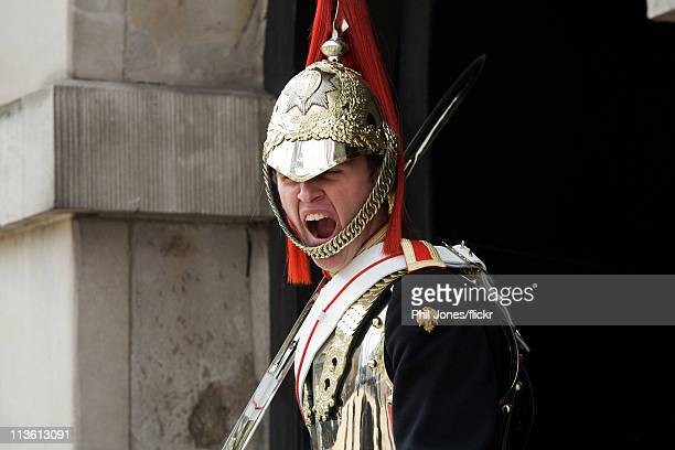 A soldier of the Blue's and Royals at Horse guards parade yawns following the Royal Wedding of Prince William to Catherine Middleton at Westminster...