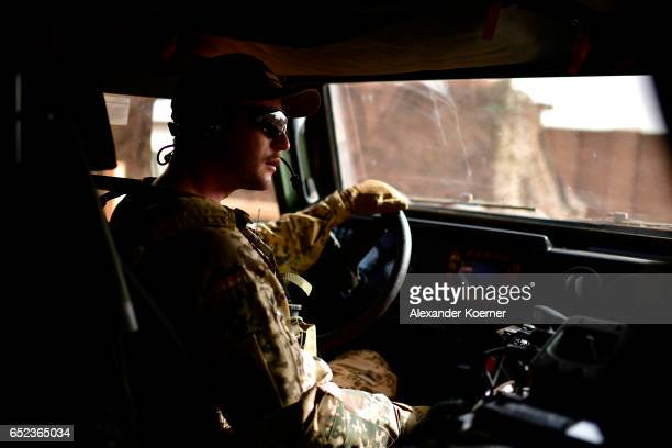 A soldier of the Bundeswehr the German Armed Forces prepares to exit Camp Castor on March 7 2017 in Gao Mali Each week locals and Touareg nomads...