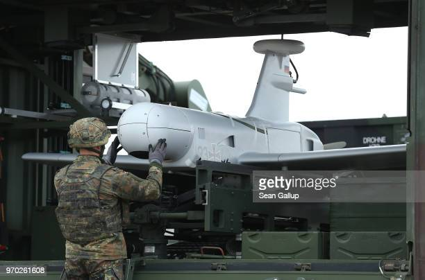 A soldier of the Bundeswehr the German armed forces readies a KZO reconaissance drone for a launch during Thunder Storm 2018 multinational NATO...