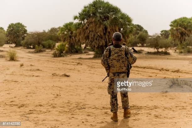 A soldier of the Bundeswehr the German armed forces watches the surroundings at Camp Castor in Gao Mali 19 May 2017 Members of the German armed...