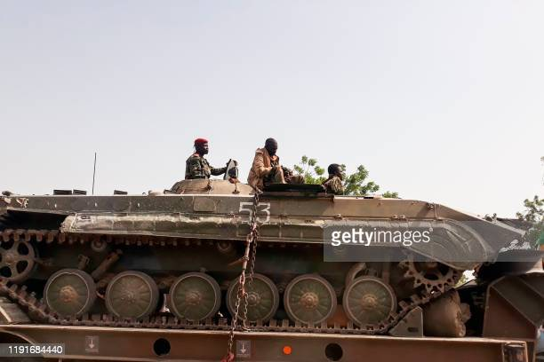 A soldier of the Chad Army sits on top of a tank that is transported on a truck in N'Djamena on January 3 upon their return after a monthslong...