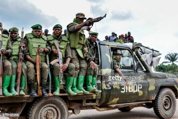 TOPSHOT Soldier of the FARDC sit on a military vehicle in an area of exchanges of fire with members of the ADF in Opira North Kivu on January 25 2018...