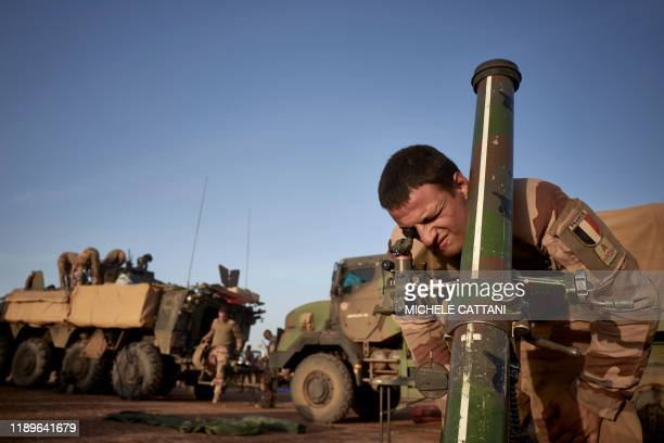 A soldier of the French Army adjusts the coordinates of a mortar ready to be used to defend them at a Temporary Operative Advanced Base during the...