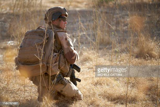 A soldier of the French Army monitors a rural area during the Barkhane operation in northern Burkina Faso on November 10 2019
