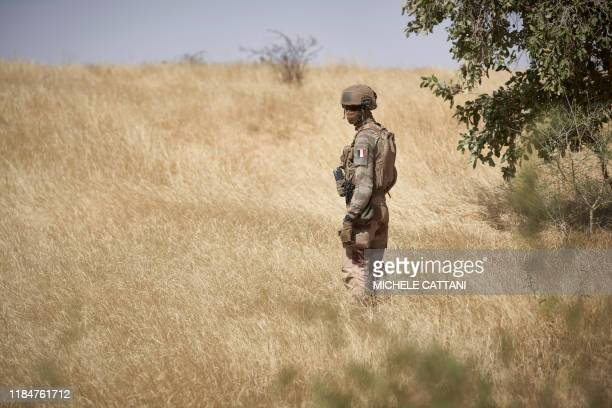 TOPSHOT A soldier of the French Army monitors a rural area during the Barkhane operation in northern Burkina Faso on November 12 2019