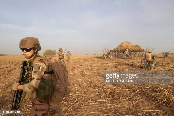 TOPSHOT A soldier of the French Army patrols a rural area during the Barkhane operation in northern Burkina Faso on November 9 2019