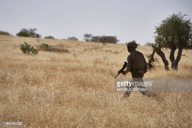 Soldier of the French Army patrols a rural area during the Barkhane operation in northern Burkina Faso on November 12, 2019.