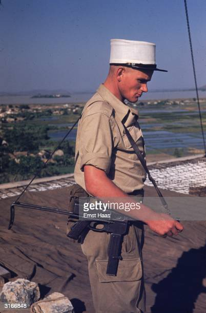 A soldier of the French Foreign Legion stands guard in the former Indochina