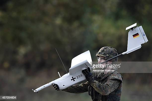 Soldier of the German Armed Forces holds the drone 'Aladin'during an excercise prior the arrival of German Defense Minister Ursula von der Leyen in...