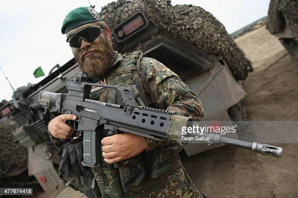A soldier of the German armed forces the Bundeswehr carries the troubled Heckler and Koch G36 aussault rifle during the NATO Noble Jump military...