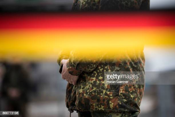 A soldier of the german army Bundeswehr is pictured behind of a banderole with the german national flag on October 26 2017 in Schnoeggersburg Germany