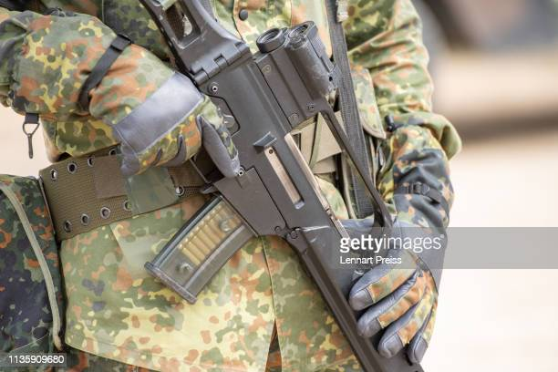 A soldier of the German Bundeswehr holds his G36 rifle during the Allied Spirit X international military exercises at the US 7th Army training center...