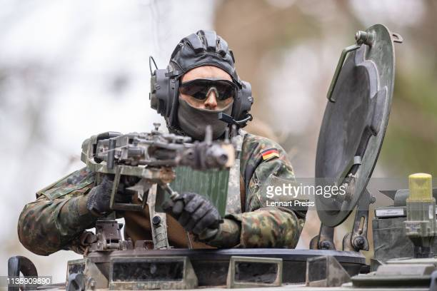 A soldier of the German Bundeswehr secures a Tactical Operations Center during the Allied Spirit X international military exercises at the US 7th...