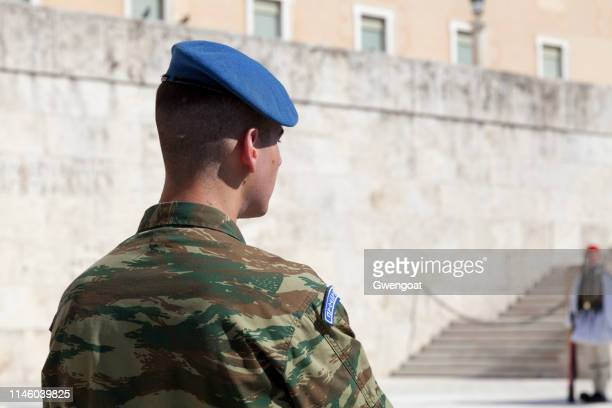 soldier of the greek presidential guard - greek parliament stock pictures, royalty-free photos & images