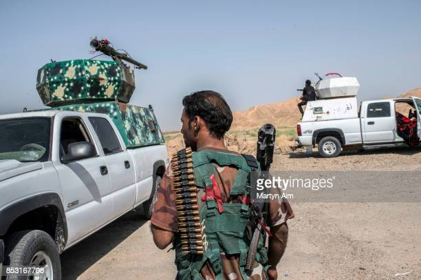 A soldier of the Hashd AlShaabi prepares to fight in an offensive to drive out Islamic State militants on September 24 2017 in Hawija Iraq The Hashd...