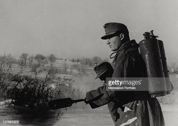 A soldier of the Hungarian army armed with a flamethrower advancing during a patrol in the Voronezh area Russia December 1942