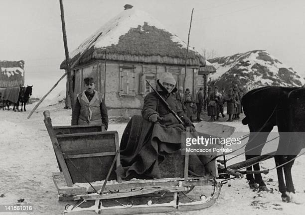 A soldier of the Hungarian army driving the sleigh that will bring the special correspondents of the 'Tempo' and 'Corriere della Sera' newspapers to...
