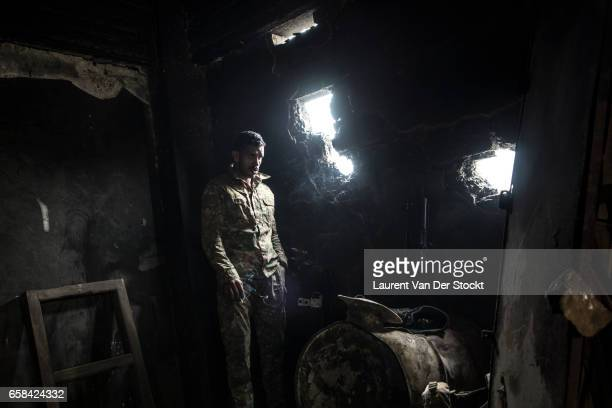 A soldier of the Iraqi Federal Police Emergency Response Division during a battle on their last position of the Wednesday Market on the frontline...
