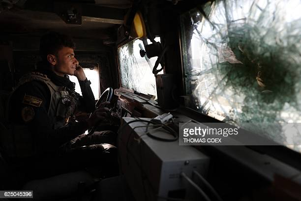 A soldier of the Iraqi Special Forces drives an armoured vehicle in the Aden district of Mosul after troops almost entirely retook the area from...