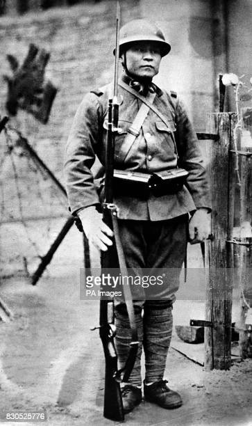 A soldier of the Japanese Imperial Army stands guard at a roadblock in Japaneseoccupied China c1937