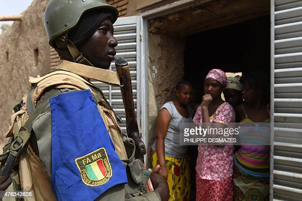 A soldier of the Malian Army Forces patrols on June 3 2015 in Goundam in the Timbuktu region during the joint operation 'La Madine 3' also involving...