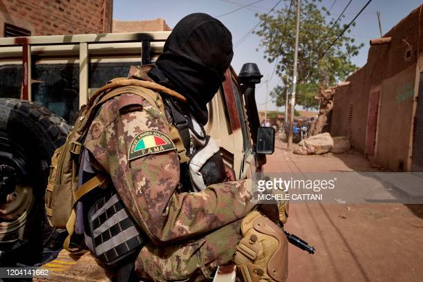 A soldier of the Malian army is seen during a patrol on the road between Mopti and Djenne in central Mali on February 28 2020 A week earlier Mali's...
