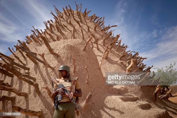 Soldier of the Malian army patrols the archaeological site of the Tomb of Askia in Gao on March 10, 2020. - The site, which was protected during the...