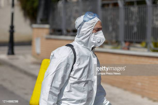 A soldier of the Military Emergency Unit completely protected is seen entering the nursing house Edad de Oro at the town of El Alamo to disinfect to...