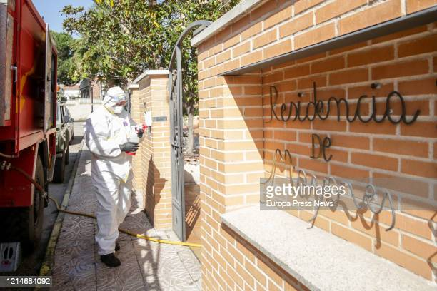 A soldier of the Military Emergency Unit completely protected prepare to disinfect the nursing house Edad de Oro at the town of El Alamo to avoid the...
