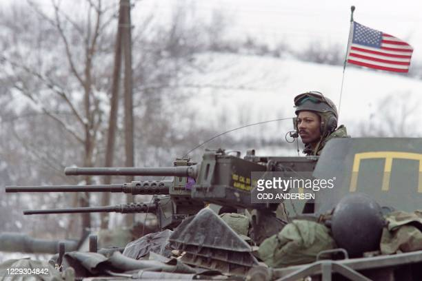 Soldier of the NATO peace implementation force stands guard on top of his Bradley fighting vehicle on January 01 1996 near the northern Bosnian city...