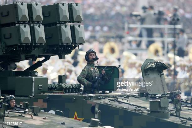 Soldier of the People's Liberation Army stands on a tank during a parade to celebrate the 70th Anniversary of the founding of the People's Republic...