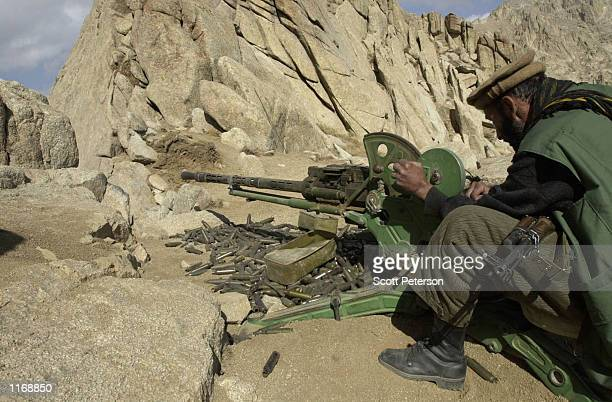 A soldier of the rebel Afghanistan Northern Alliance stands guard October 24 2001 at a position atop the strategic Salang Pass which alliance...