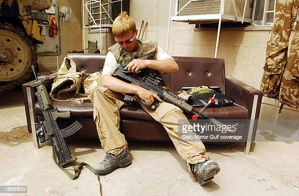 """Soldier of the Royal Scots Dragoon Guards, the 7th Armoured Brigade """"The Desert Rats,"""" mans an operational post April 4, 2003 on the outskirts of..."""
