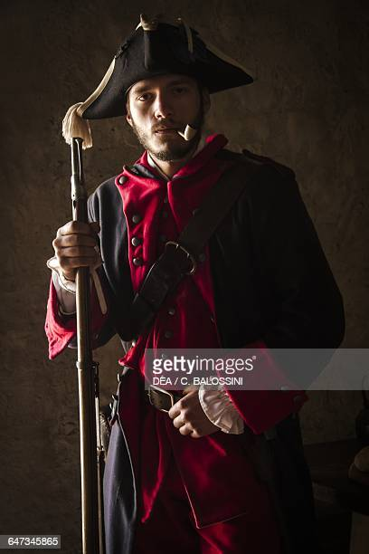 Soldier of the Saluzzo regiment with tricorn pipe and muzzleloading flintlock rifle Kingdom of Sardinia army 18th century Historical reenactment