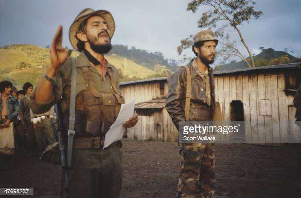 A soldier of the Sandinista Popular Army addresses workers on a state coffee plantation Nicaragua 1986