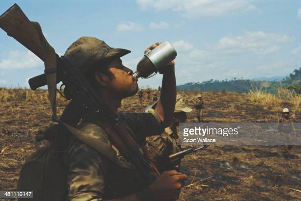 A soldier of the Sandinista Popular Army drinking from a water bottle Nicaragua 1985