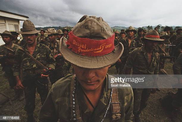 A soldier of the Sandinista Popular Army wearing a hat band showing his support for Sandinista leader Daniel Ortega Nicaragua 1990