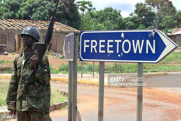 A soldier of the Sierra Leone's army stands next to a direction board in Masiaka some 100 kilometres east from Freetown 17 may 2000 on the frontline...