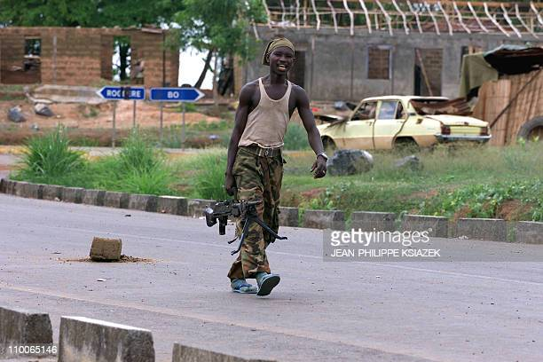 A soldier of the Sierra Leone's forces walks in a street of Masiaka some 100 kilometres east from Freetown 17 may 2000 on the frontline Sierra Leonan...