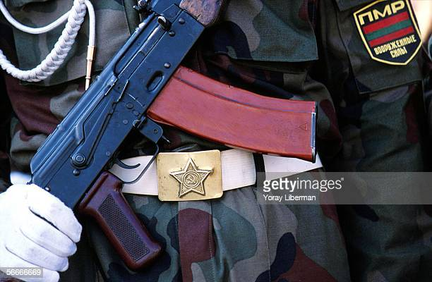 A soldier of the Transnistrian Army marches with a Kalashnikov and a Soviet Union's belt during the 10th Transnistrian independence ceremony in the...