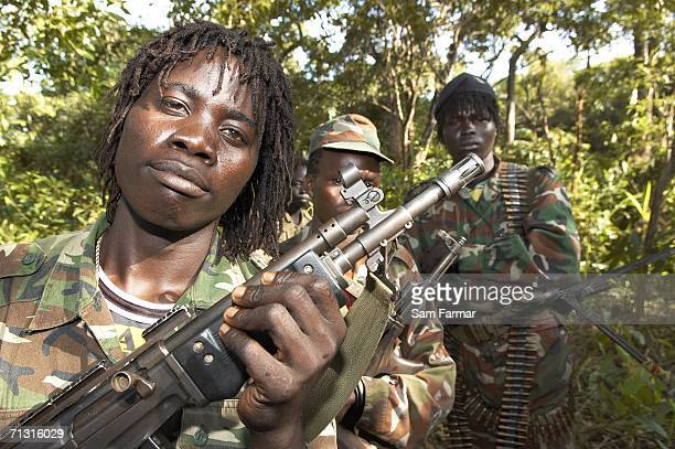 Soldier of the Ugandan rebel group, the Lord's Resistance Army, pose with their weapons during a rare appearance in front of journalists in this...