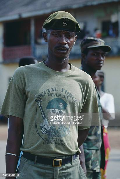 A soldier of the United Liberation Movement of Liberia for Democracy wears a Special Forces tshirt in Monrovia during the Liberian Civil War In 1989...