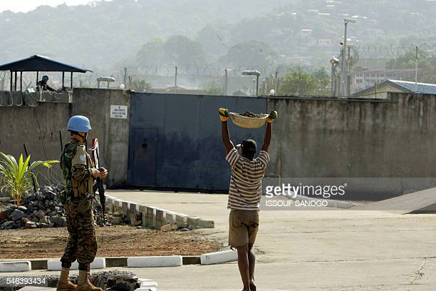 A soldier of the United Nations mission to Sierra Leone stands guard 31 March 2006 in front gate of the Special Court for Sierra Leone in Freetown...