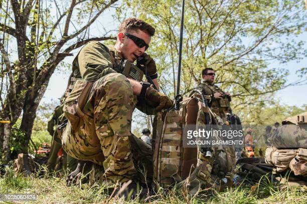 A soldier of the US Air Force talks on the radio during an earthquake simulation exercise held by Air Force troops from Colombia the Dominican...