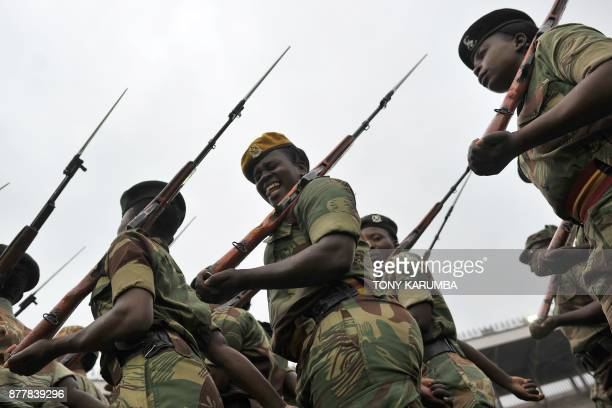 TOPSHOT A soldier of the Zimbabwe Defence Force pulls a funny face as she marches in formation during drills on November 23 2017 to prepare for the...