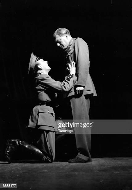 A soldier on his knees to another soldier in the play 'Take Back My Freedom' at the Neighbourhood Theatre
