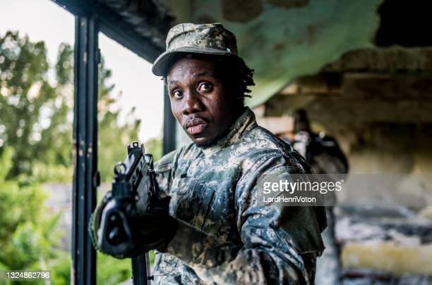 soldier on mission - military invasion stock pictures, royalty-free photos & images