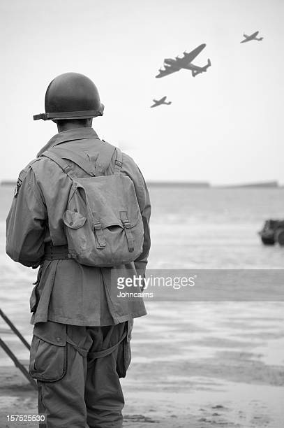 soldier on  omaha beach. - army soldier stock pictures, royalty-free photos & images