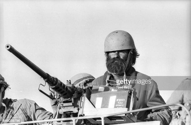 Soldier on top of armored vehicle with his machine gun on the Golan Heights during the Yom Kippur war